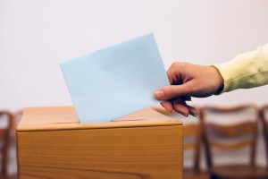 women in election with ballots and ballot box